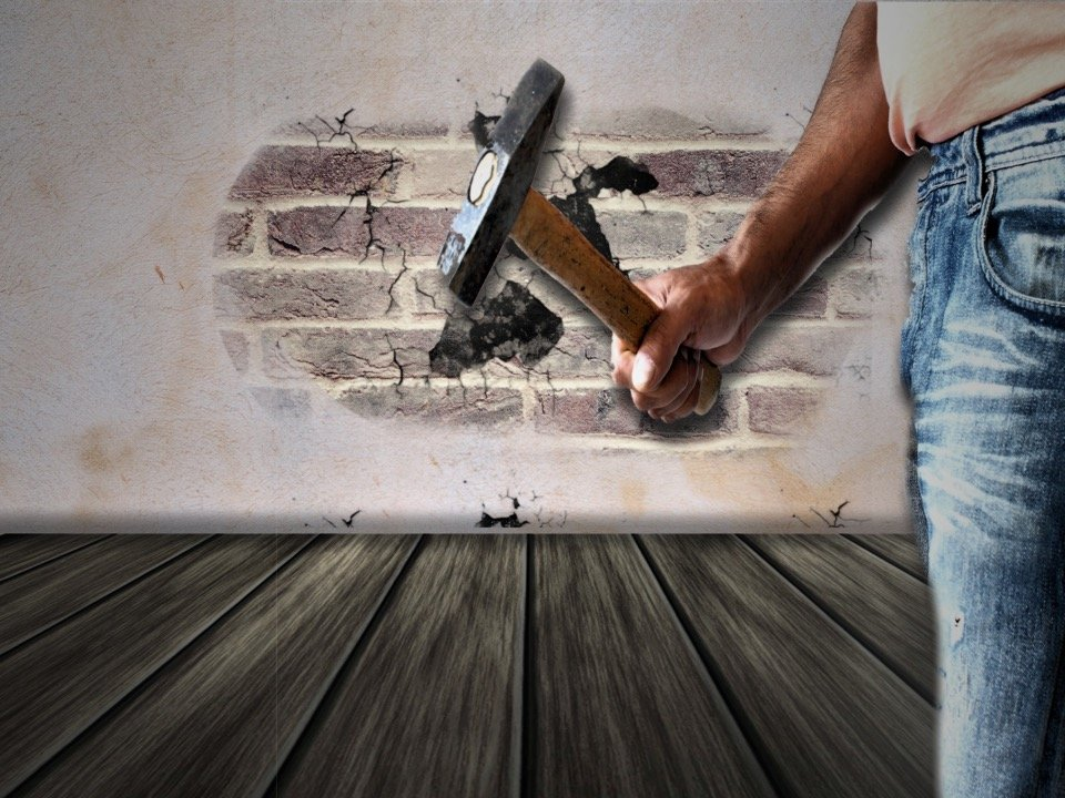 radium ecommerce renovation blog - hand with a hummer