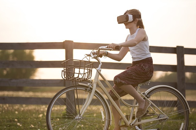 eradium top 5 technology trends blog augmented reality: a girl on a bike wearing AR glasses